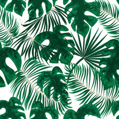 seamless pattern of bright green tropical leaves on black background. Tropical palm leaves, jungle leaves seamless vector floral pattern background.