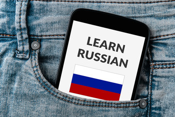 Learn Russian concept on smartphone screen in jeans pocket. All screen content is designed by me. Flat lay