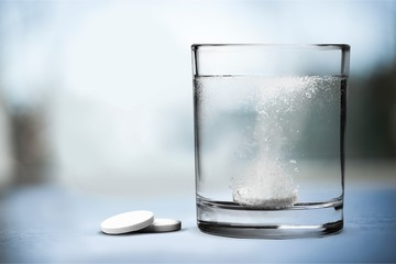 Glass on water and pill