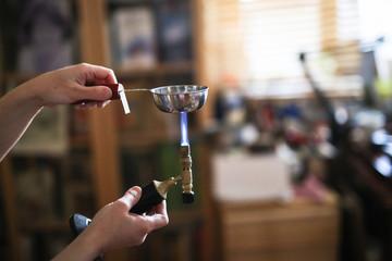 Home workshop girl master on gas burner boil water