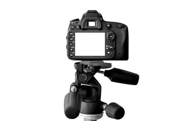 Modern Dslr camera with empty screen on tripod, isolated on white background