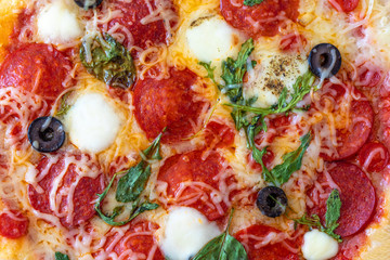 Pizza pepperoni Pattern Background. Fresh baked Pepperoni Pizza with mozzarella cheese, Basil leaf  and tomato sauce..