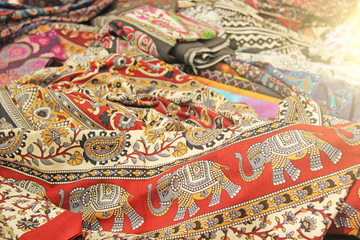 Cloth with elephant India. Red oriental fabric with a pattern and ornament of an elephant