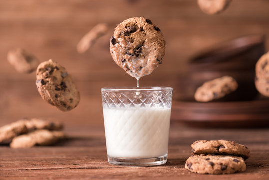 Cookie falls into the glass of milk.