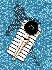 girl in bikini lies on mattress in ocean with shark silhouette