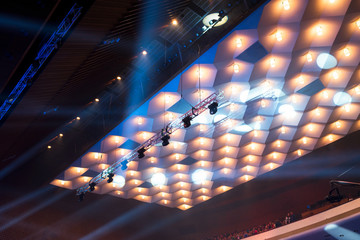 chandeliers and stage lights under the ceiling of the concert hall