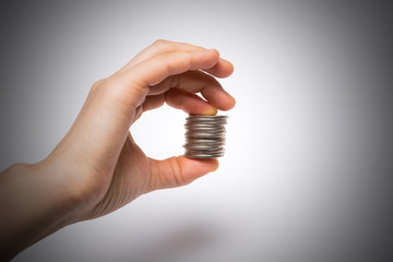 Woman hand putting an korea coin isolated on a white background
