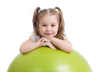 Happy sportive child playing with fitness ball isolated on white background