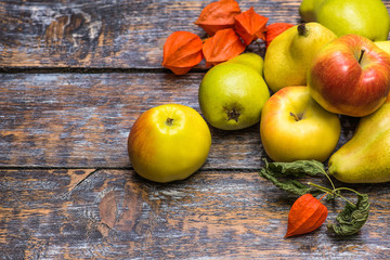Apples and pears, autumn harvest on wooden background