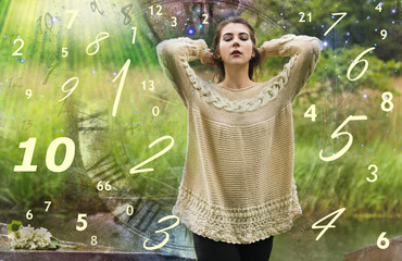 The woman meditates in the world of figures, numerology, a ritual
