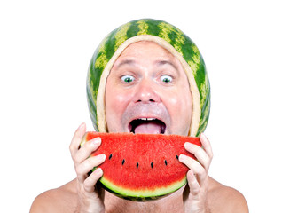 Portrait of cheerful man with a helmet of watermelon eating a water melon, isolated on a white background.