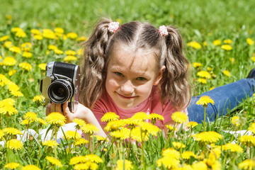 Baby girl taking pictures outdoors