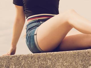 Female buttocks in denim shorts Fototapete