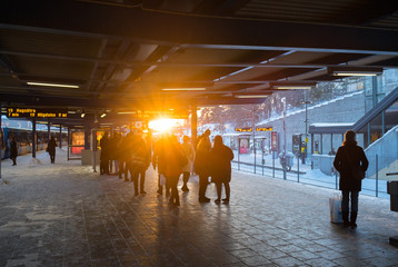Stockholm sunrays at the metro station throught some people