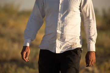 White dirty shirt on a man in the nature