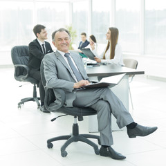 successful businessman with documents on the background of the office