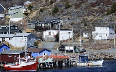 view across the bay towards the small  fishing village Petty Harbour Maddox Cove, Avalon region  of Newfoundland