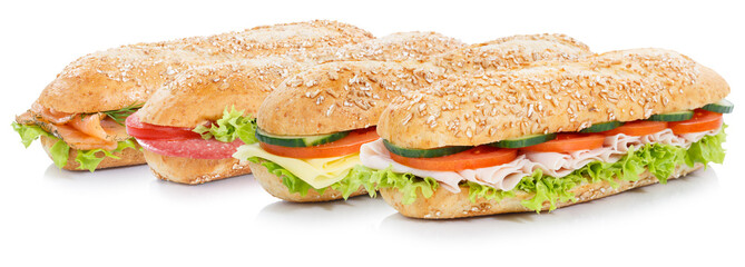 Sub sandwiches with salami ham cheese salmon fish whole grains isolated on white