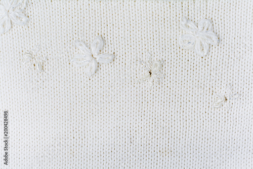 8d70e66bab94e Sweater or scarf fabric texture large knitting. Knitted jersey background  with a relief pattern. Wool hand- machine