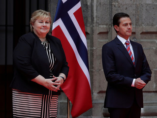 Norway's PM Erna Solberg and Mexico's President Enrique Pena attend an official welcoming ceremony, in Mexico City