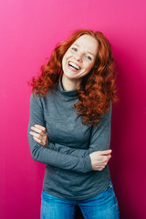 Young redhead woman with a vivacious smile