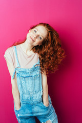 Young cheerful woman wearing overalls