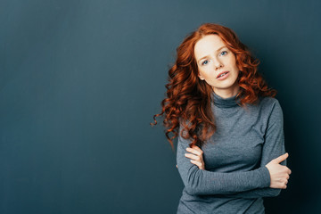 Pretty young redhead woman staring at camera