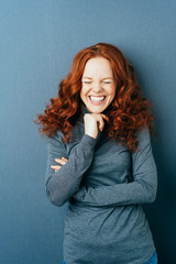 Portrait of young laughing red-haired woman