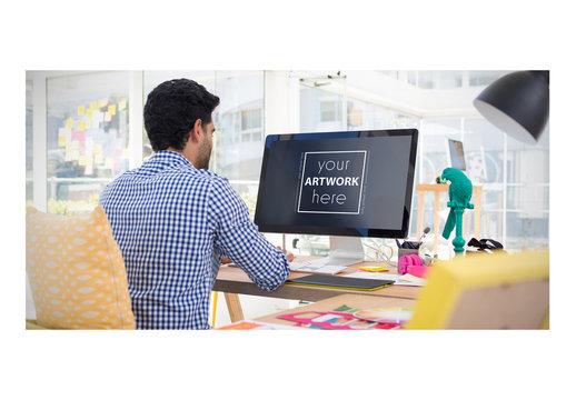 Desktop User at Desk Mockup