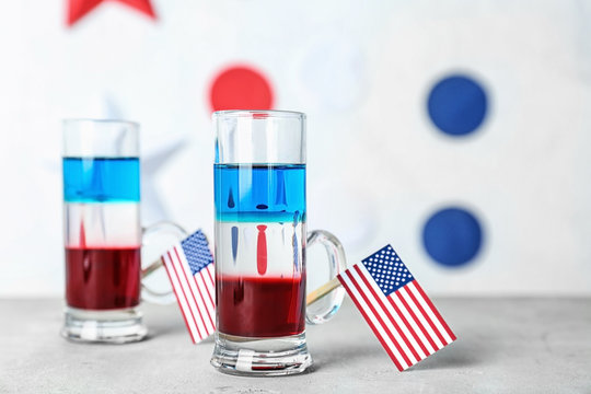 Layered cocktails in colors of American flag on table