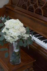 Bouquet by the piano