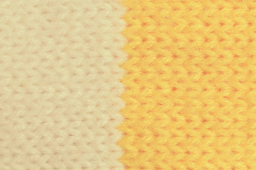 Textile texture of wool is yellow and white in color.