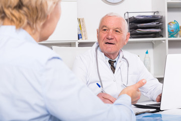 Male doctor with female client