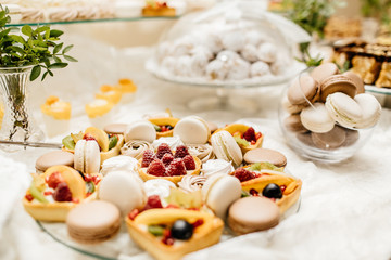Candy bar with macarons, cakes, cheesecakes, cake pops. Colorful