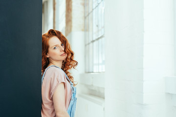 Thoughtful attractive young woman with red hair