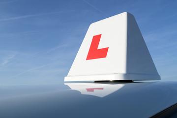 British driving school car roof sign