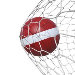 Latvia Latvian flag soccer ball inside the net, in a net.