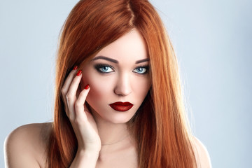 Fashion Beauty Model Woman Long Red Hair. Red Matte Lips and Nails. Blue Eyes.