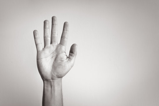 Hand showing five fingers. Hand making sign stop.
