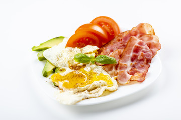 bacon and eggs with avocado and tomato, bread and coffee