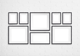 Black wooden photo frames mockup, eight pieces set collection isolated on white bricks wall , 3d illustration