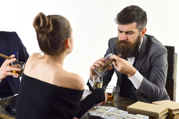 Company engaged in illegal business. Men and woman sitting at table with piles of money. Illegal deal concept. Businessmen discussing illegal deal while drinking and smoking, white background.