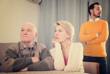 Man seriously talking with family