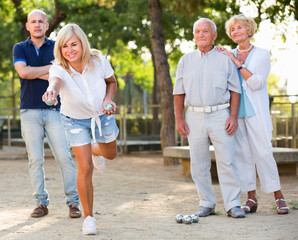 Happy family playing petanque in outdoor