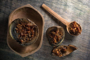 borojo fruit, considered a superfood,  in a wooden bowl on rustic background