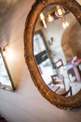 Vintage gold mirror in restaurant interior, close up