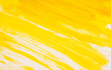 Texture of yellow watercolour paint. Horizontal background with watercolor brush strokes.