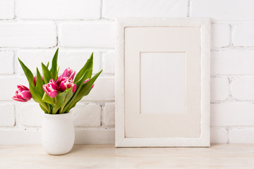 White frame mockup with magenta pink tulip in the flower pot