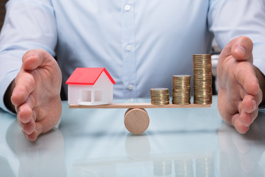 Protecting Balance Between House Model And Stacked Coins