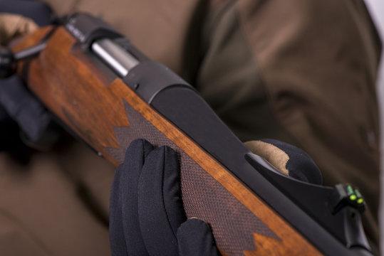 the hunter's gun in his hands